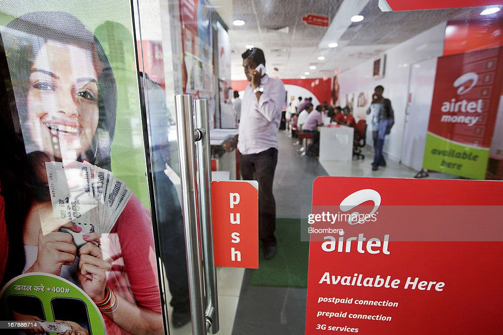 A customer makes a call at the Bharti Airtel Ltd. flagship store in Mumbai, India on Thursday, May 2, 2013. Bharti Airtel, India's largest mobile-phone operator, posted profit that missed analyst estimates after a weaker rupee raised the interest payments and prices for network equipment. Photographer: Kuni Takahashi/Bloomberg via Getty Images