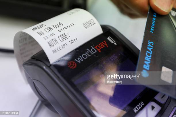 A customer makes a contactless card payment using a Barclays Plc debit card on a Worldpay Group Plc card payment machine in a retail outlet in London...