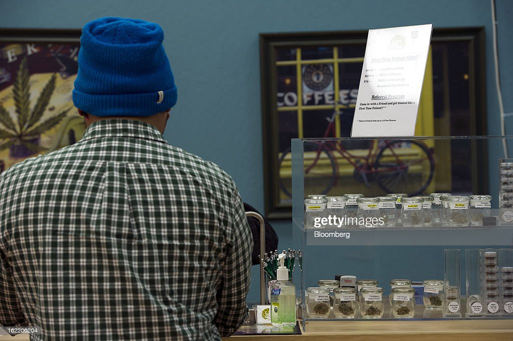 A customer makes a purchase at the ARC Healing Center medical-marijuana dispensary in San Jose, California, U.S., on Thursday, Feb. 7, 2013. San Jose is the medical-marijuana capital of Silicon Valley with 106 clinics, about twice as many per square mile as Los Angeles. Photographer: David Paul Morris/Bloomberg via Getty Images
