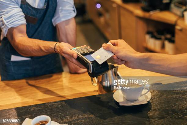 Customer making a contactless payment