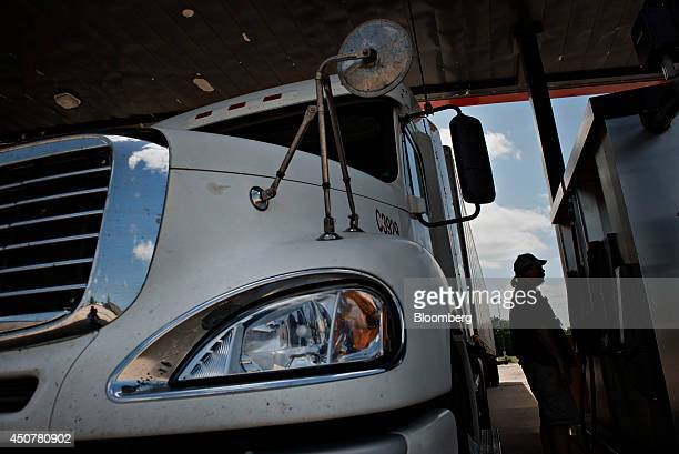 Customer Marcus Rudy fuels his tractor trailer at a Road Ranger gas station in Princeton Illinois US on Tuesday June 17 2014 Gasoline in the US...