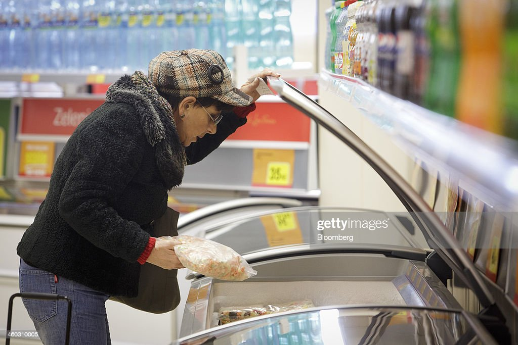 A customer opens the door of a freezer unit to select bags of frozen vegetables inside an Iceland Foods Ltd. store in Prague, Czech Republic, on Friday, Jan. 3. 2014. The Czech Republic's 2013 budget deficit of 80.9 billion koruna ($4.01 billion) beat the 100 billion-koruna target after the government cut spending, the Finance Ministry said. Photographer: Martin Divisek/Bloomberg via Getty Images