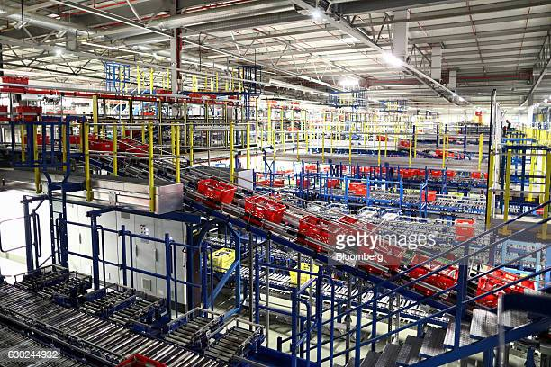 Customer order crates travel along a conveyor belt at the Ocado Group Plc distribution centre in Dordon UK on Friday Dec 16 2016 Ocado provides home...