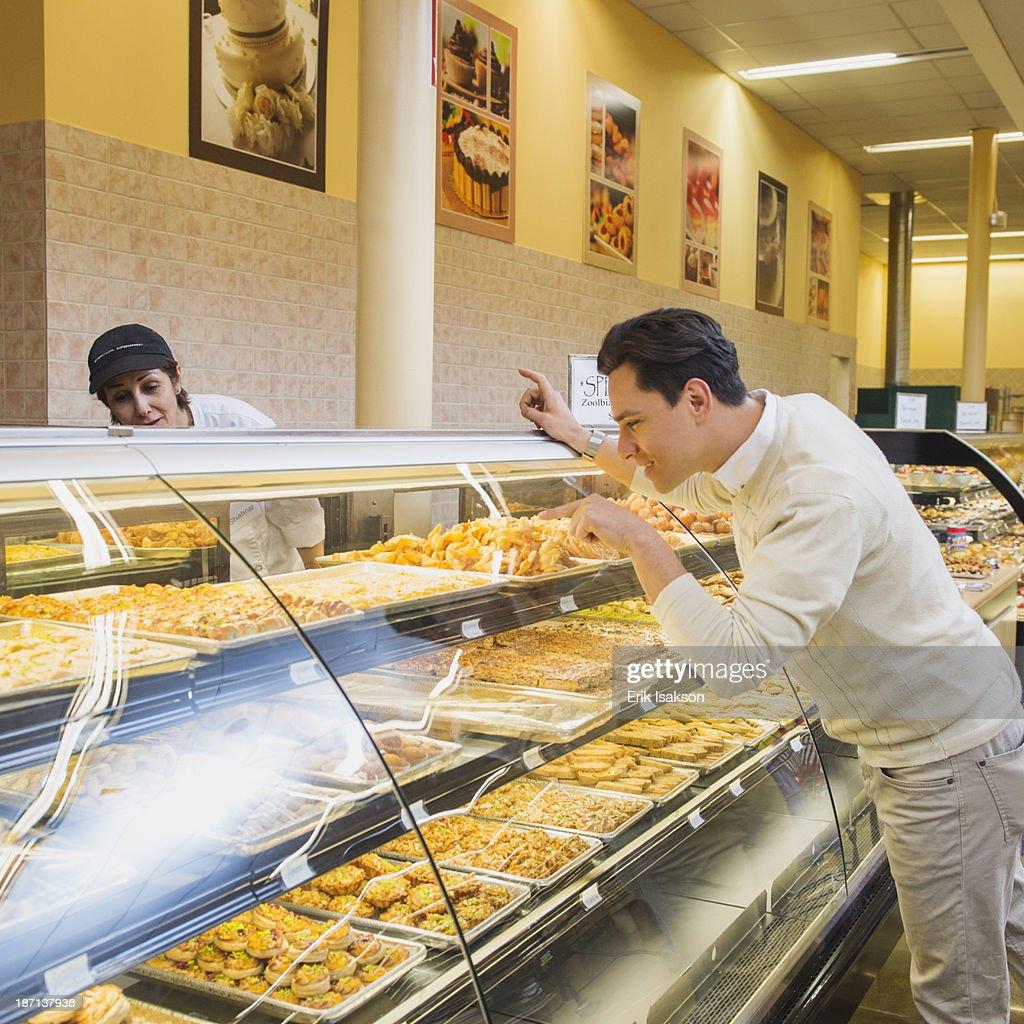 Customer ordering at restaurant counter : Stock Photo