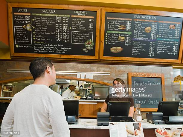 Customer ordering food at bakery