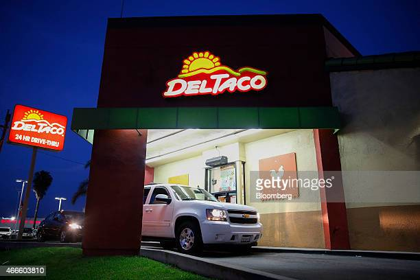 A customer orders at the drivethru of a Del Taco restaurant in Gardena California US on Saturday March 14 2015 Del Taco the Mexican chain known for...
