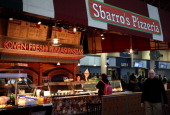 A customer orders food at the Union Station location of pizza restaurant chain Sbarro March 10 2014 in Washington DC Sbarro filed for bankruptcy...