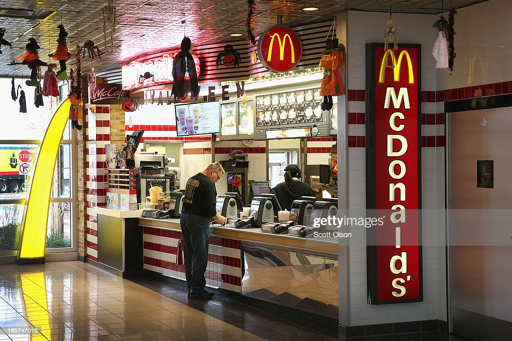 A customer orders food from a McDonald's restaurant on October 24, 2013 in Des Plaines, Illinois. McDonald's has announced it will make changes to its low-priced Dollar Menu, which includes items like coffee, small fries, hamburgers and apple pies. The new menu, dubbed the Dollar Menu and More, will offer some higher priced options such as the grilled Onion Cheddar Burger and a McChicken sandwich.