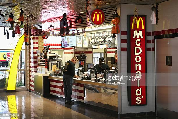 A customer orders food from a McDonald's restaurant on October 24 2013 in Des Plaines Illinois McDonald's has announced it will make changes to its...