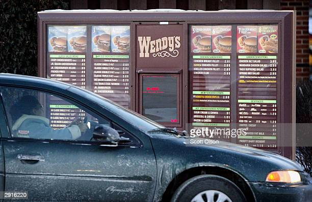 30 A customer orders from the driveup menu at a Wendy's restaurant January 30 2004 in Chicago Illinois Wendy's the nation's third largest hamburger...