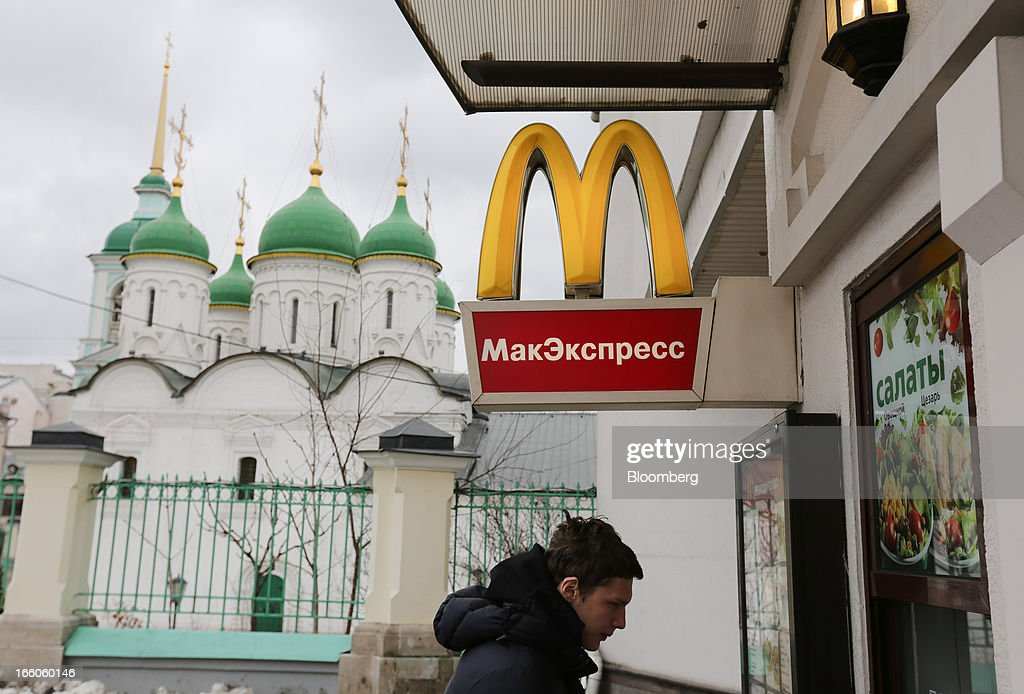 A customer orders his meal from a service window outside a McDonald's food restaurant in Moscow, Russia, on Sunday, April 7, 2013. McDonald's Corp., which virtually created the market for burgers and fries in the country and convinced Russians it's OK to eat with their hands, must fend off a growing challenge from rivals Burger King Worldwide Inc., Subway Restaurants, Yum! Brands Inc. and Wendy's Co. Photographer: Andrey Rudakov/Bloomberg via Getty Images