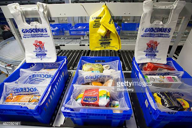 Customer orders sit in plastic carrier bags at a Tesco Plc online distribution center in Erith UK on Wednesday Nov 27 2013 Tesco Plc the UK's largest...