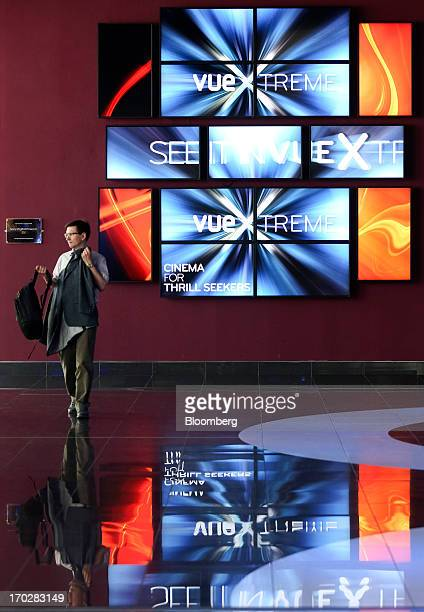 A customer passes a multiscreen display in the lobby of a Vue Cinema operated by Vue Entertainment Ltd at the Westfield Stratford City retail complex...