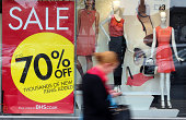 A customer passes a 'Sale' sign in the window display of a BHS store operated by Arcadia Group Ltd in BurtonuponTrent UK on Tuesday Aug 26 2014 As...