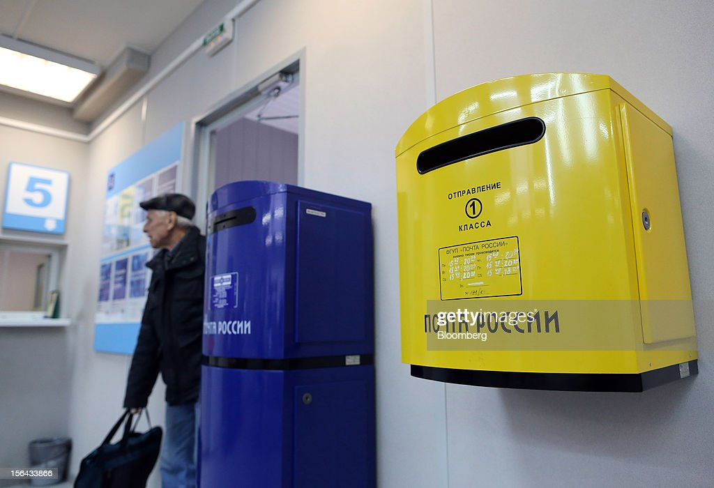 A customer passes multi-colored mail boxes inside a post office, operated by Russian Post, in Moscow, Russia, on Wednesday, Nov. 14, 2012. Alexander Kiselev, Russian Post's chief executive officer, needs to invest 200 billion rubles through 2020 to turn around a company that described its infrastructure as 'the most expansive, but the least efficient' in a strategy plan this year. Photographer: Andrey Rudakov/Bloomberg via Getty Images