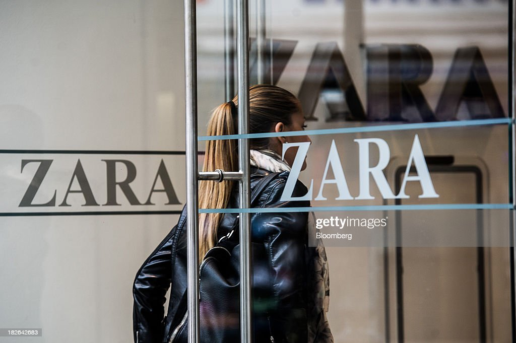 A customer passes through the branded glass entrance doors of a Zara fashion store, operated by Inditex SA, in Budapest, Hungary, on Wednesday, Oct. 2, 2013. 'The retail sales environment in Europe, especially in Spain, has become less challenging in the last few weeks, while the weather overall has also been more stable,' Anne Critchlow, a London-based analyst at Societe Generale, said. Photographer: Akos Stiller/Bloomberg via Getty Images
