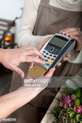 customer paying flower  with credit card : Stock Photo