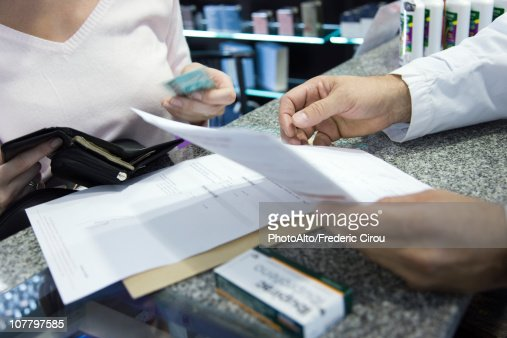 Customer paying for prescription, cropped