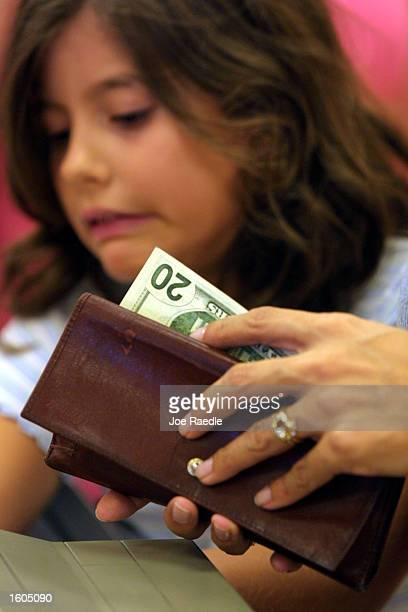 A customer pays for her purchases at a Target department store July 27 2001 in MiamiDade County FL Consumers are being lured by backtoschool sales...