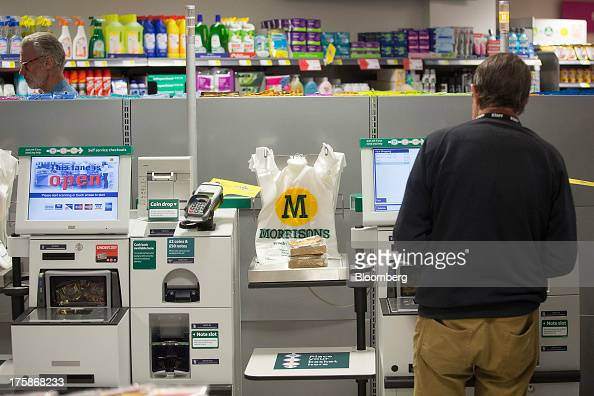 A customer pays for his goods at a selfservice checkout counter inside a Morrisons M Local store operated by William Morrison Supermarkets Plc in...