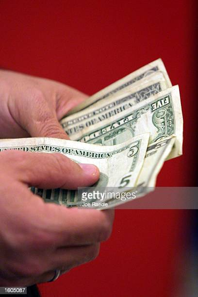 A customer pays for his purchases at a Target department store July 27 2001 in MiamiDade County FL Consumers are being lured by backtoschool sales...