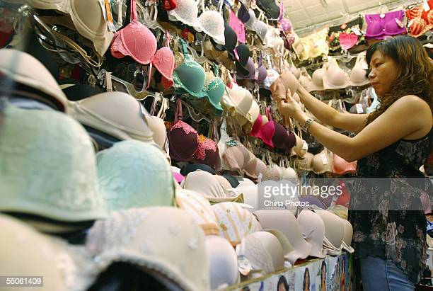 A customer picks bra at a store on September 6 2005 in Guangzhou of Guangdong Province China China and the European Union reached an agreement on...
