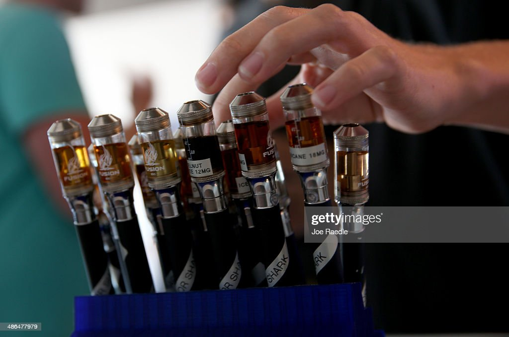 A customer picks from different flavors of electronic cigarette vapor as they shop at the Vapor Shark store on April 24, 2014 in Miami, Florida. Brandon Leidel, CEO, Director of Operations Vapor Shark, said he welcomes the annoucement by the Food and Drug Administration that they are proposing the first federal regulations on electronic cigarettes, which would ban sales of the popular devices to anyone under 18 and require makers to gain FDA approval for their products.