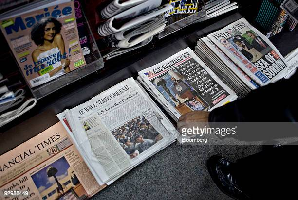 A customer picks up a copy of the New York Post at a newsstand in New York US on Wednesday Nov 11 2009 US newspaper circulation declines steepened in...