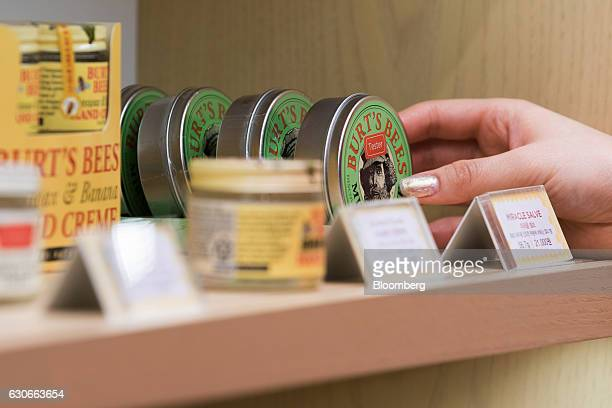 A customer picks up a tub of moisturizer at a Burt's Bees Inc store a subsidiary of Clorax Co in Seoul South Korea on Thursday July 2 2015 At a time...