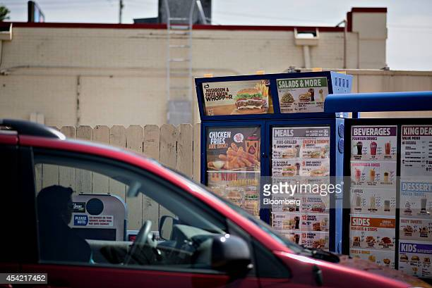 A customer places an order at the drivethrough of a Burger King Worldwide Inc restaurant in Peoria Illinois US on Tuesday Aug 26 2014 Burger King...