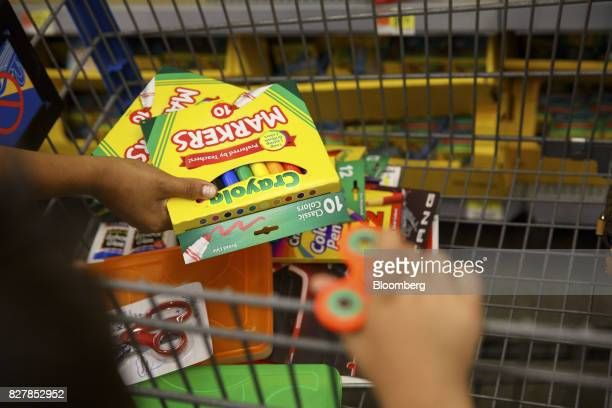 A customer places Crayola LLC markers into a shopping cart at a WalMart Stores Inc location in Burbank California US on Tuesday Aug 8 2017 WalMart...