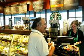 A customer places his order July 2 2003 in a Starbucks coffee shop at Dupont Circle in Washington DC Starbucks' stocks advanced $167 to $27 after the...