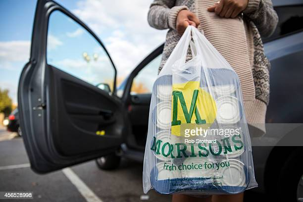 A customer places Morrisons shopping bags in their car on October 2 2014 in London England Morrisons who reported a fall in halfyear profits of more...