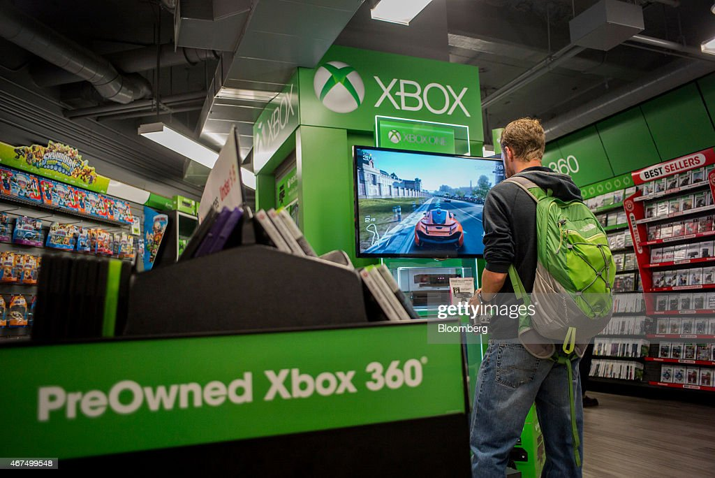 A customer plays a Microsoft Corp. Xbox 360 video game at a GameStop Corp. store in San Francisco, California, U.S., on Tuesday March 24, 2015. GameStop Corp. is scheduled to release earnings figures on March 26. Photographer: David Paul Morris/Bloomberg via Getty Images