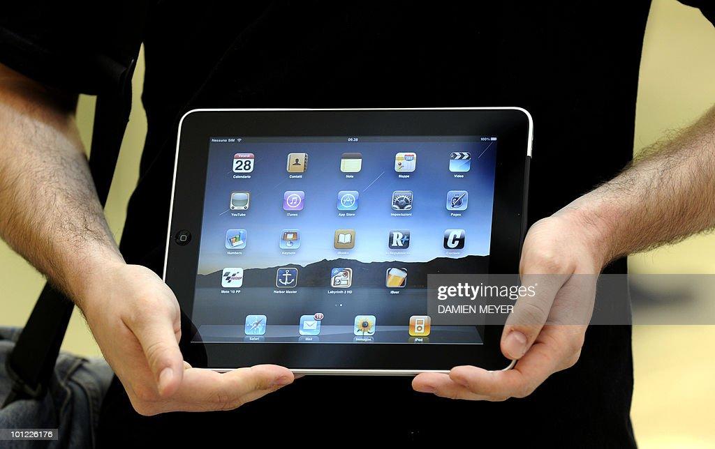 A customer poses with his new purchase, an ipad from the apple store in Carugate, a suburb of Milan as the iconic ipad tablet computer goes on sale on May 28, 2010. Apple's much-hyped iPad went on sale in a swathe of countries from Australia and Japan to Europe at the start of a global rollout tipped to change the face of computing.