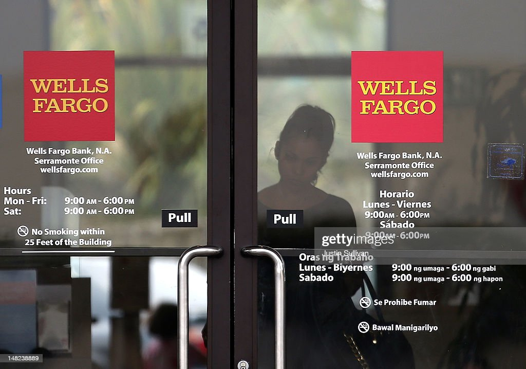 A customer prepares to leave a Wells Fargo Bank branch office on July 12 2012 in Daly City California The Justice Department announced Thursday that...