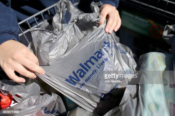 A customer prepares to load her car with the purchases she made at a Walmart store on February 19 2015 in Miami Florida The Walmart company announced...