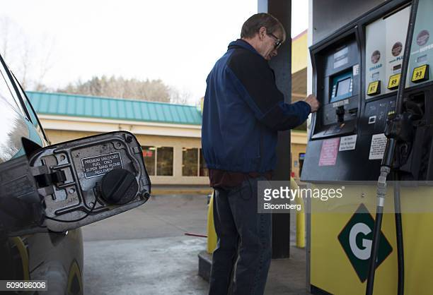 A customer prepares to pump fuel at a Go Mart Inc gas station in Rockbridge Ohio US on Saturday Feb 6 2016 Thanks to a glut of oil that has spurred...