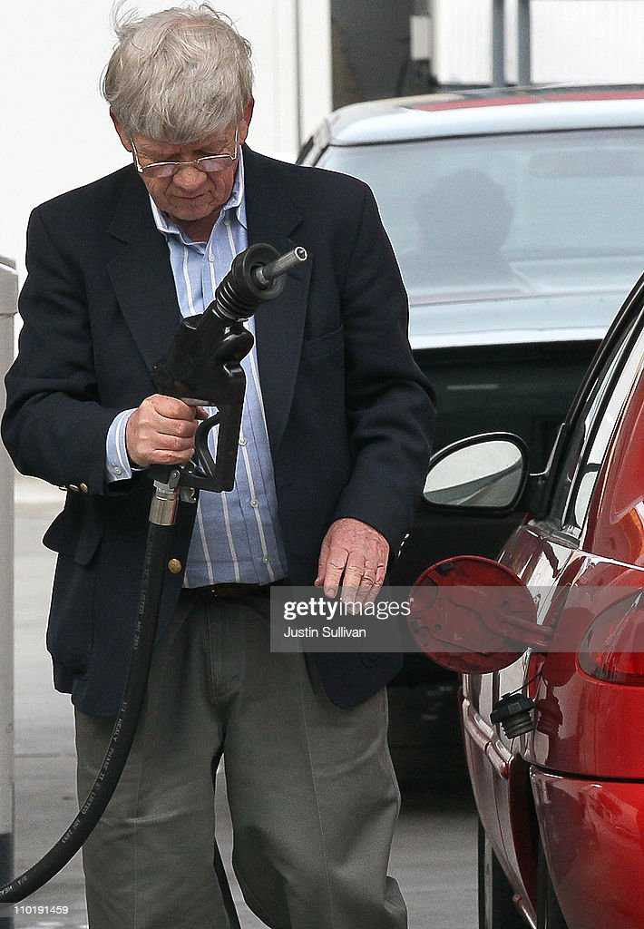 A customer prepares to pump gas into his car at a Shell gas station on March 16, 2011 in San Francisco, California. Wholesale prices in the United States spiked last month with a 3.3% rise in energy prices and a 3.9% jump in food prices.