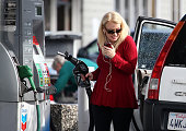 A customer prepares to pump gasoline into her vehicle at a Chevron gas station on February 9 2015 in San Rafael California After weeks of decline in...