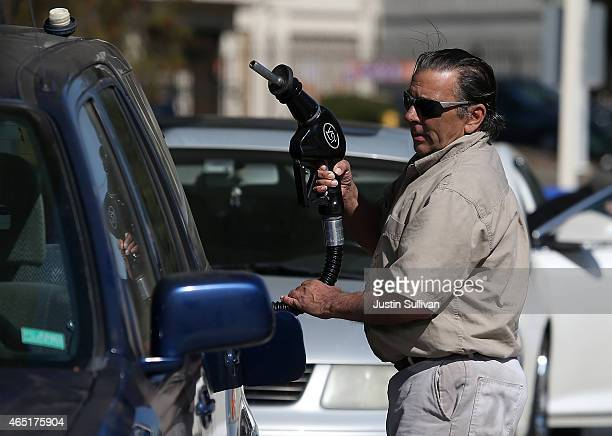 A customer prepares to pump gasoline into his car at an Arco gas station on March 3 2015 in Mill Valley California US gas prices have surged an...
