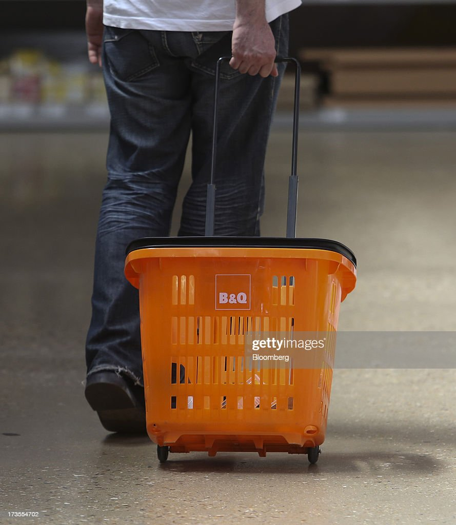 A customer pulls a shopping basket as he browses the aisles inside a B&Q home improvement store, operated by Kingfisher Plc, in London, U.K., on Tuesday, July 16, 2013. Financial assistance for first-time home buyers in Britain is likely to prompt a resurgence of do-it-yourself spending after several years of decline, according to Kingfisher Plc Chief Executive Officer Ian Cheshire. Photographer: Chris Ratcliffe/Bloomberg via Getty Images