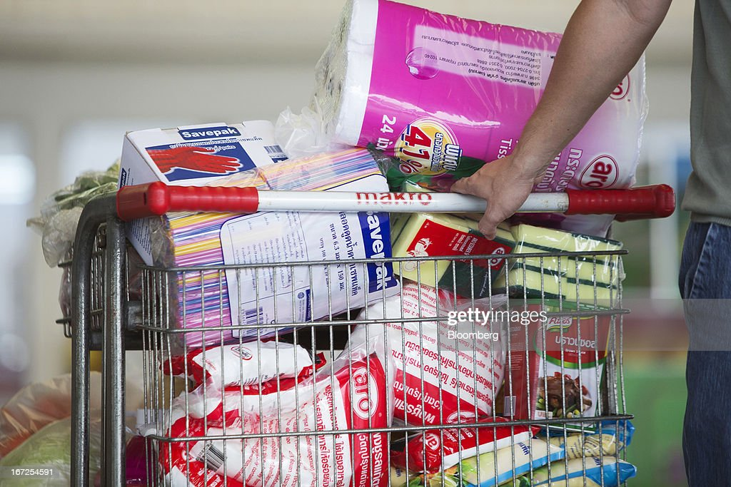 A customer pulls a shopping cart full of groceries at a Makro store, operated by Siam Makro Pcl, in Bangkok, Thailand, on Tuesday, April 23, 2013. Billionaire Dhanin Chearavanont's CP All Pcl, Thailand's 7-Eleven chain, offered to pay about $6.6 billion for discount retailer Siam Makro Pcl in the biggest takeover announced in Asia this year. Photographer: Brent Lewin/Bloomberg via Getty Images