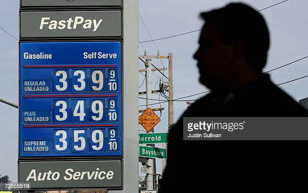 A customer pumps fuel into his car at a Chevron gas station March 12 2007 in San Francisco California Gasoline prices have surged over 20 cents in...