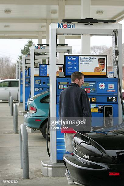 A customer pumps gas at a Mobil station January 30 2006 in Plainfield Illinois Exxon Mobil posted a record $1071 billion profit for the fourth...