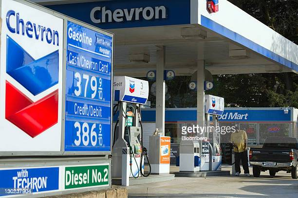 A customer pumps gasoline at a Chevron Corp gas station in Berkeley California US on Monday Oct 24 2011 Chevron Corp is expected to announce...