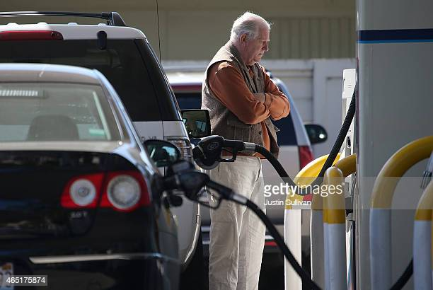 A customer pumps gasoline into his car at an Arco gas station on March 3 2015 in Mill Valley California US gas prices have surged an average of 39...