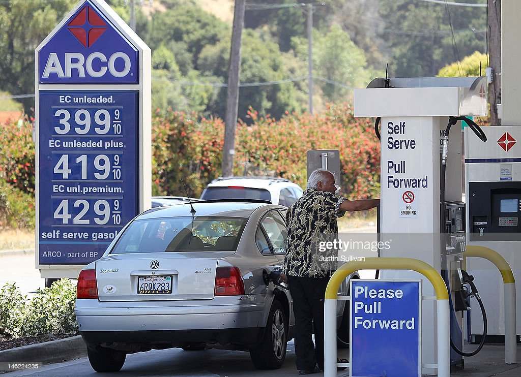A customer pumps gasoline into his car on June 12, 2012 in Mill Valley, California. According to the Energy Department's weekly fuel survey, the average pump price in California dropped 9.6 cents in the past week to bring the price of a gallon of regular gasoline to $4.164 compared to $4.260 one week earlier.