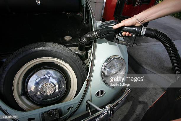 A customer pumps gasoline into his Volkswagen Beetle at a service station May 7 2007 in San Francisco California Gas prices reached a record national...