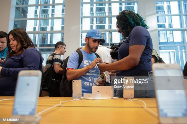 A customer purchases a new iPhone 8 at the Fifth Avenue Apple Store September 22 2017 in New York City The new iPhone 8 and iPhone 8 Plus as well as...
